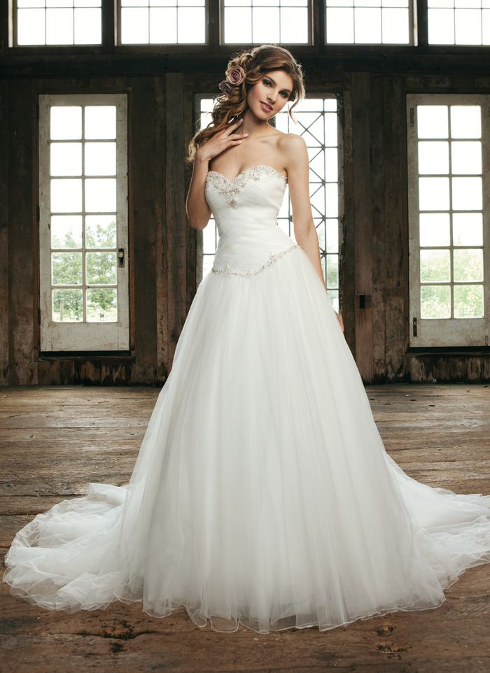 Sincerity wedding dress style 3676  Strapless sweetheart basket weave of tulle with beaded appliques, Basque waist line full tulle skirt, corset back and a chapel train