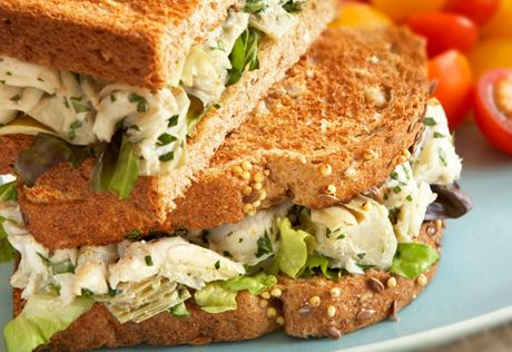 Hearty whole grain bread makes the perfect complement for this easy-to-prepare crabmeat salad that's seasoned with chopped artichoke hearts for a unique and delicious twist.