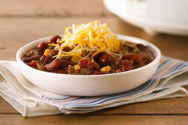 Combine ground beef, beans & cheese for a tasty foundation to this easy slow-cooker chili. Serve with sour cream or bacon bits for extra flavor and color.