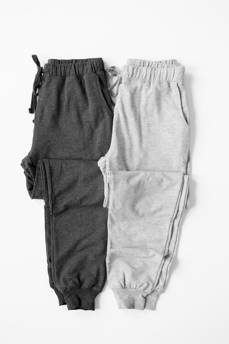 - Casual and comfy knit joggers - Elasticated and drawstring waistband - Side pockets - Stretchy french terry (classic sweatpants) knit material - Available in grey or charcoal - 57% Cotton 38% Polyes