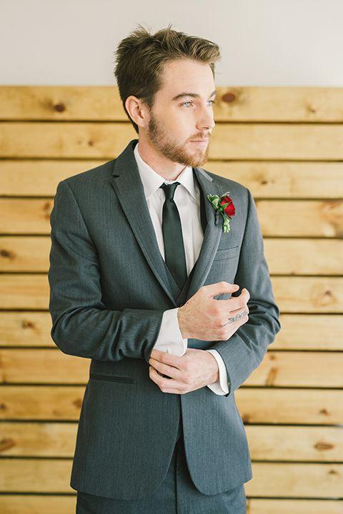 Orange-county-wedding-at-the-colony-house-groom-grey-tuxedo-holding-sleeve