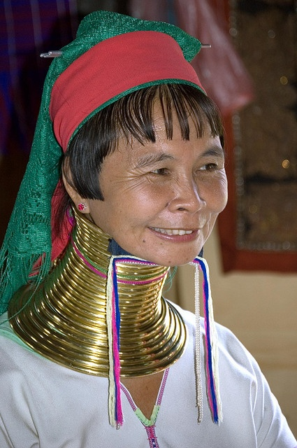 Padaung lady from Thailand...they start putting the rings on as a child & add as they get older. They come off for very rare occasions.