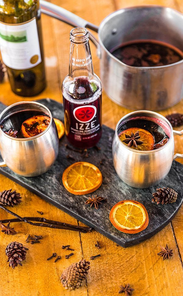 Our IZZE Mulled Wine cocktail is the perfect winter warm up. Ingredients: 4 cups Pomegranate IZZE, 1 bottle red wine, 1/4 cup honey, 3 cinnamon sticks, 1 tested orange, 4 whole cloves, 3 star anise