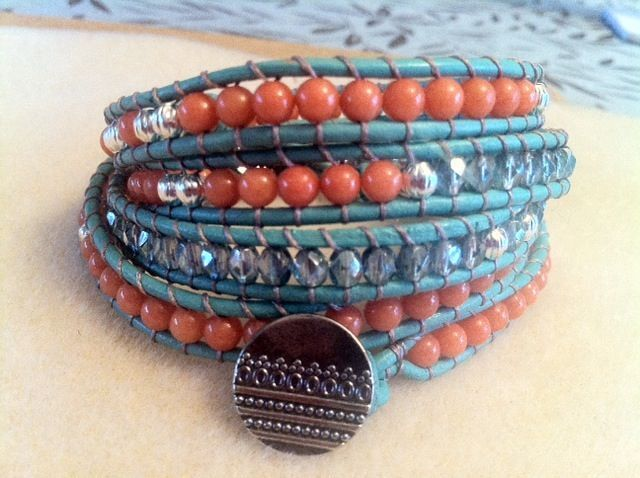 ($75.00) Blue leather wraps around 5x with coral jade beads and Czech crystal blue beads accented with silver beads.