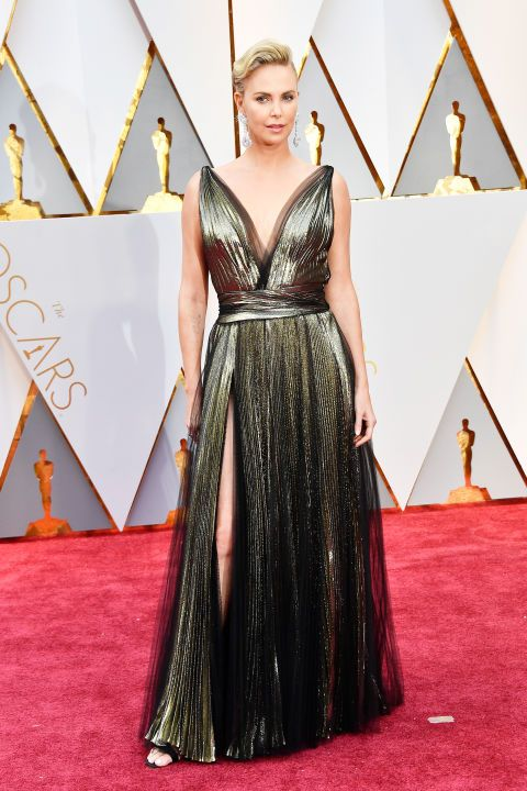 See all the red carpet arrivals at the 89th Annual Academy Awards: Charlize Theron in Dior