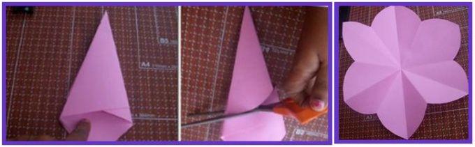 2 Затем сверните заготовку пополам. Обрежьте ножницами кривой край, закруглив срез. Разверните заготовку, у получившегося цветка лепестки не в одну сторону вогнуты, поэтому сделайте их все одинаковыми. Изготовьте ещё один такой же цветочек, только меньшего размера.