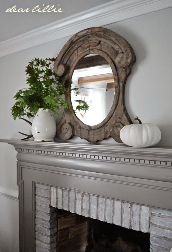 Light gray walls, white trim, darker gray fireplace mantel. (Dear Lillie: Some Painting in the Family Room)