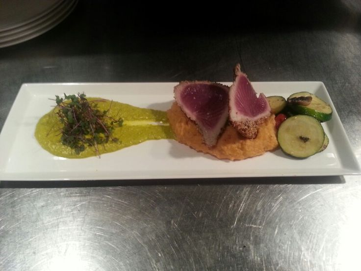 Sesame crusted blackfin tuna, thai chili mashed potato, ginger saffron pea puree