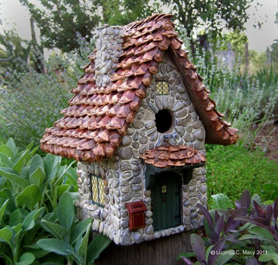 Stone Cottage:  http://www.etsy.com/listing/77650152/little-stone-cottage-songbird-house