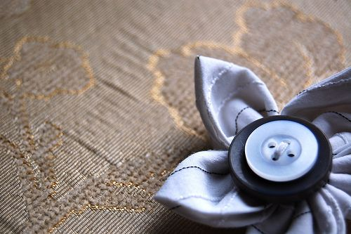 flowers and buttons... and i hate flowers, but this is a great idea!