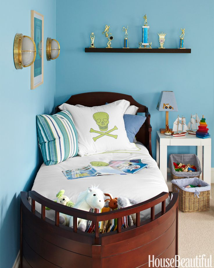 In an East Hampton, New York, house, the son sails to sleep on Pottery Barn Kids' Pirate Bed. Bulkhead sconces from Shiplights.com. Paint is Benjamin Moore's Ocean Breeze.   - HouseBeautiful.com