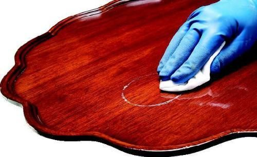 Repair stains, rings, and minor scratches in wood furniture. Cover each scratch with a liberal coat of Petroleum free jelly, let sit for 24 hours, rub into wood, wipe away excess, and polish as usual.