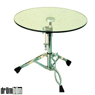 For drummers and percussionists everywhere! They call this a drum table but it should really be called a snare stand table. This unique piece of modern furniture features a round slab of glass mounted on a chrome snare stand base.