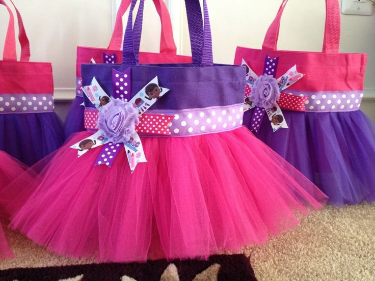 Our Doc McStuffins tutu tote Great to use for party favor bags for a Doc McStuffins themed party.  www.facebook.com/gigglesandwigglestutus
