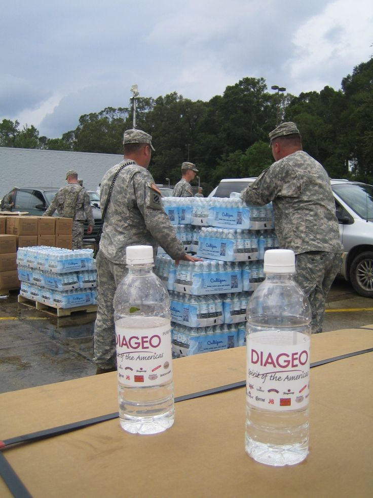Hurricane Gustav Baton Rouge LA: Bridge Foundation-supplied water bottles are loaded into residents' cars with help from the National Guard at the Baker staging area.