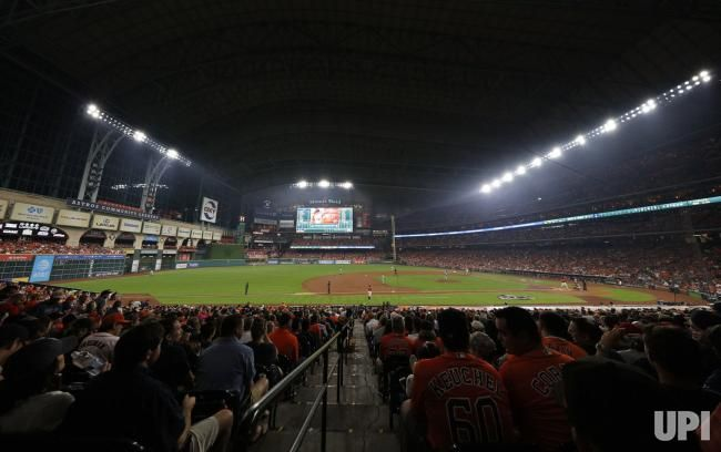 Fans watch the Houston Astros and the New York Yankees during the first inning of Game 1 of the ALCS at Minute Made Park in Houston on…
