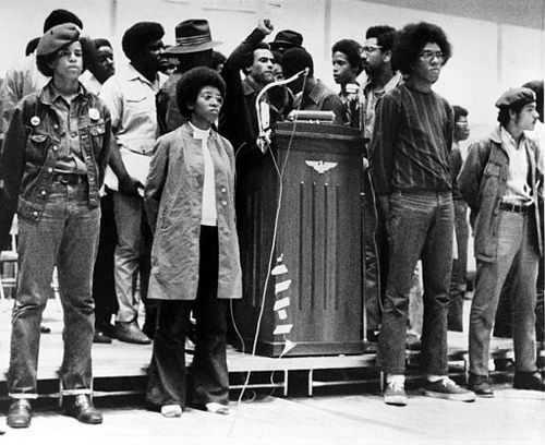 afro-art-chick:  BLACK PANTHER HUEY NEWTON Huey  P. Newton, national defense minister of the Black Panther Party, raises  his…