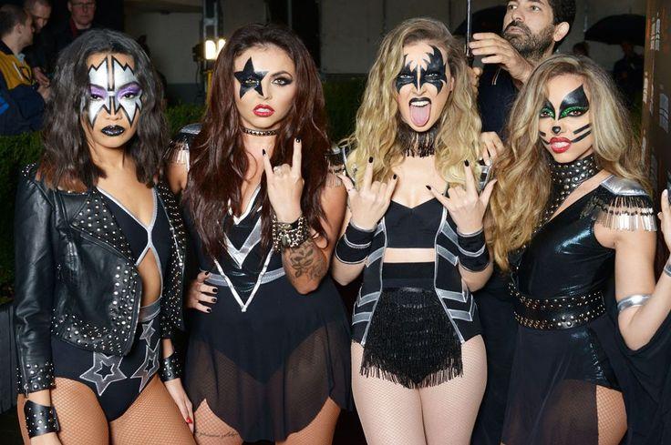 cuatro mujeres vestidas de estrellas de rock kiss