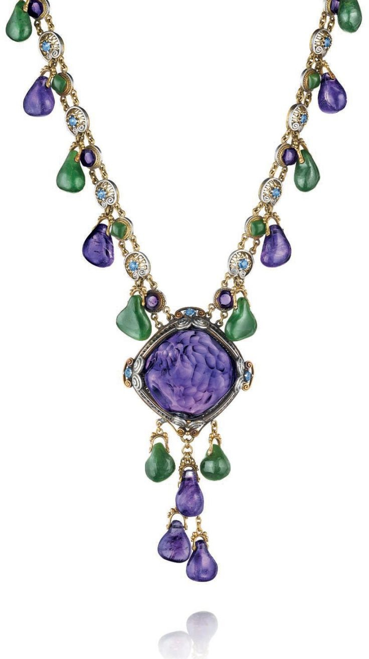 LOUIS COMFORT TIFFANY, TIFFANY & CO. - A NEPHRITE, AMETHYST AND SAPPHIRE NECKLACE, CIRCA 1920. The freeform amethyst, carved at the reverse, set within a platinum and gold filigree and wirework surround, suspending nephrite and amethyst bead fringe, to the similarly set fringed neckchain, set with alternating nephrite and amethyst cabochons, with circular-cut sapphire detail, mounted in platinum and gold Signed Tiffany & Co. #LouisComfortTiffany