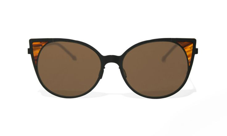 Channel your inner Marilyn with desert glam frames that can withstand a  sandstorm.  These flexible cateyes were built to last with jewelry-grade matte black  ion plating on lightweight stainless steel, complete with dark brown lenses  and brown tortoise shell acetate accent pieces.
