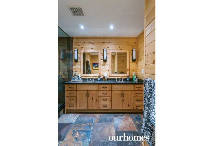 The custom vanity in the main bathroom has two sinks and lots of storage. Slate floors anchor the room.   http://www.ourhomes.ca/articles/build/article/viceroy-cottage-becomes-recharging-retreat?full=true#sthash.Rnu855dl.dpuf