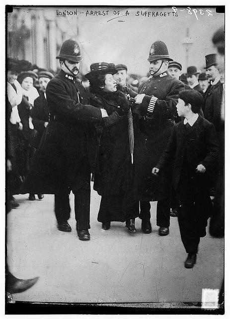 London - arrest of a suffragette. Circa 1910.