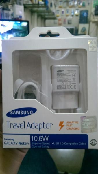 Charger USB Samsung GALAXY Note 4 Ori 100%, Adaptive Fast Charging, Travel Adapter, 10.6W, Superior Speed,  USB 3.0, Compatible cable optimal safety.  bs jg di gunakan untuk samsung type lain dan bisa di guanakan brand lain selain Samsung. I  Pembelian Qty, Harga bs di Nego yah boss, Agan, Boss & Guysss....  Online shop for you... and your store.  Pengiriman Bisa dikirim via Tiki, JNE & POS. Thank You Cust & BL Team  Thanks & BR,  Pipi P2B