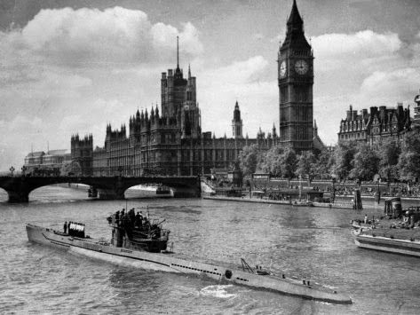 A surrendered U-boat in the Thames River, London, 1945.