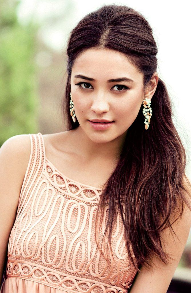 Shay Mitchell is a Canadian actress and model. Her birth name is Shannon Ashley Mitchell and she was born on April 10, 1987 in Mississauga, Canada. She is the daughter of Mark Mitchell and Precious Garcia. Both of her parents work in finance.