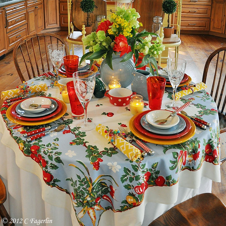 love this!---great use of vintage mixed with the new fiesta ware and vintage table cloth with the new napkins....Centerpiece too tall for intimate dining, but like the use of the fiesta ware pitcher & flowers