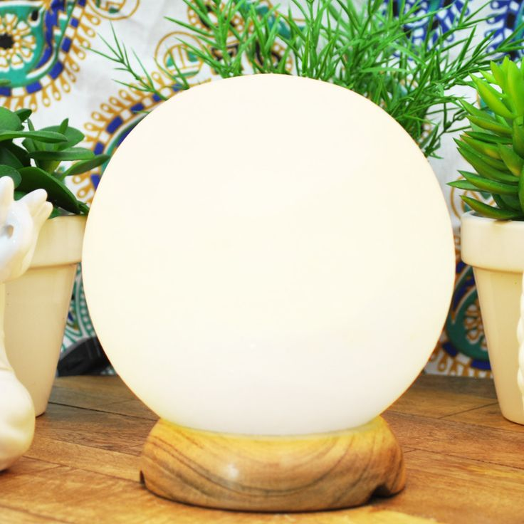 Globe White Himalayan Salt Lamp. Globe Himalayan Salt Lamp is an amazing addition to your home or office. When turned on it gives off an amazing soft amber glow and creates a soothing atmosphere. Size: 6 Inch height Weight: 5.0 to 8 lbs