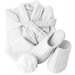 Polyester 100% wellness set, with waffle design, consisting of: a bathrobe with two front pockets, a wash cloth (approx. 30 x 31 cm), a pair of slippers with small anti-slip silicon dots, all folded together and tied with a matching ribbon. Microfibre / P
