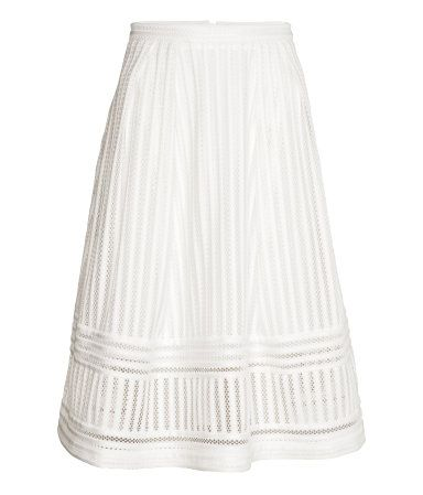 Flared skirt in textured woven fabric. Box pleats at waist and visible zip at back. Unlined.