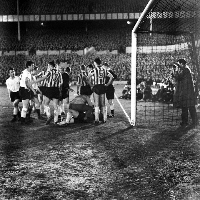 Sheffield Wednesday players remonstrate with Spurs' centre-forward Bobby Smith after he had unceremoniously poleaxed goalkeeper Ron Springett in a game at White Hart Lane in 1961