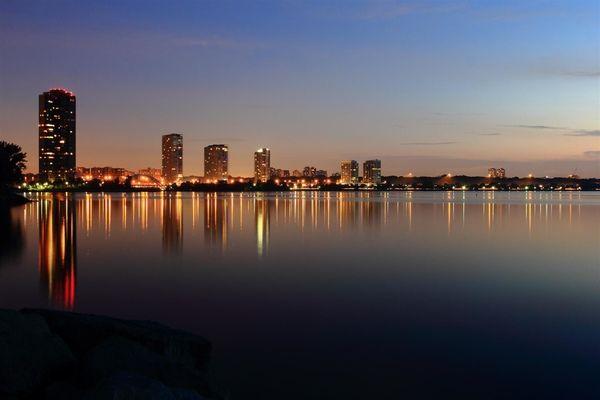 City reflection on Lake Ontario by dusk