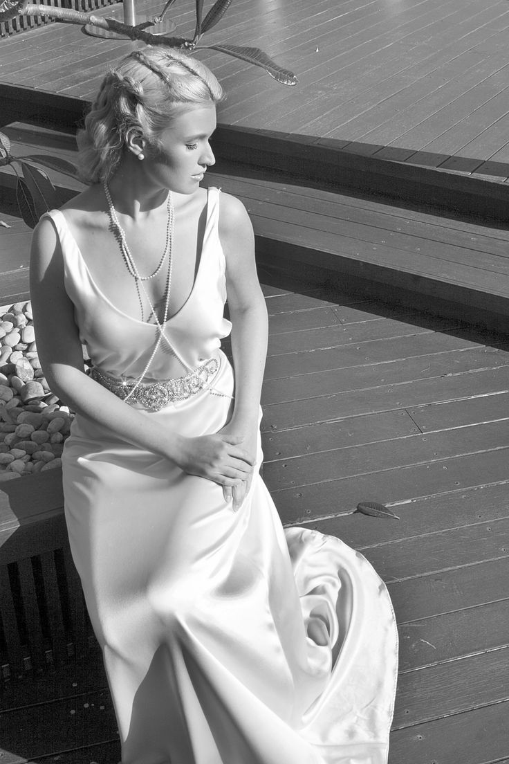 Delicate, slinky wedding gown with crystal details by Hilde Heim