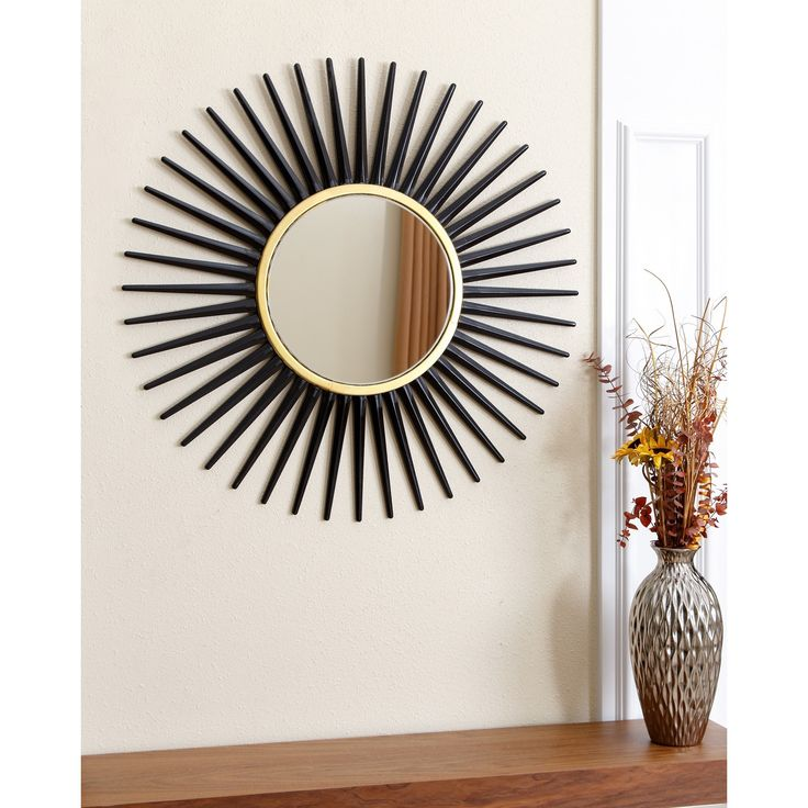 Give your home or office a new look with this great Abbyson Living mirror. Resembling a sun, this round wall mirror offers a stately black and gold design.