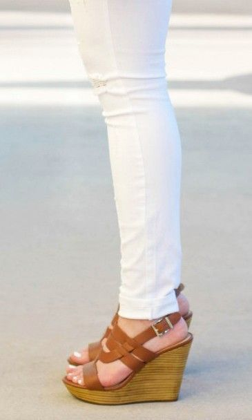Tan wedge sandals in a walkable platform silhouette with a stacked heel and an adjustable slingback closure