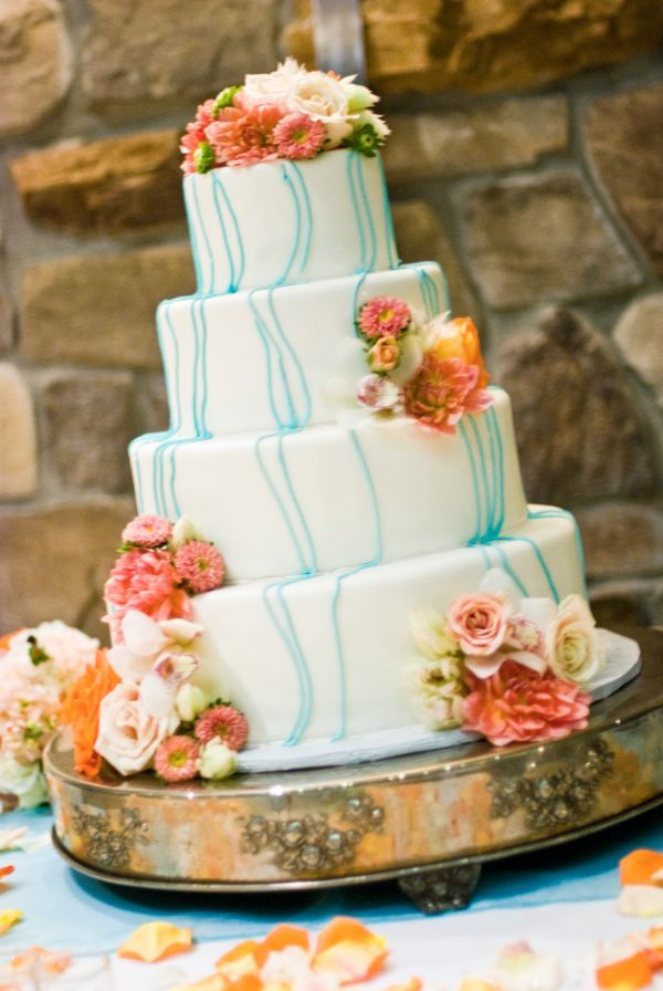Wedding Cake With Coral Colored Flowers