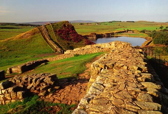 Hadrian's Wall (or part of it at least). Built by the Romans to protect them from the barbarian Scots to the north. If memory serves there's a picture of me standing on the wall (probably not supposed to but there you have it).