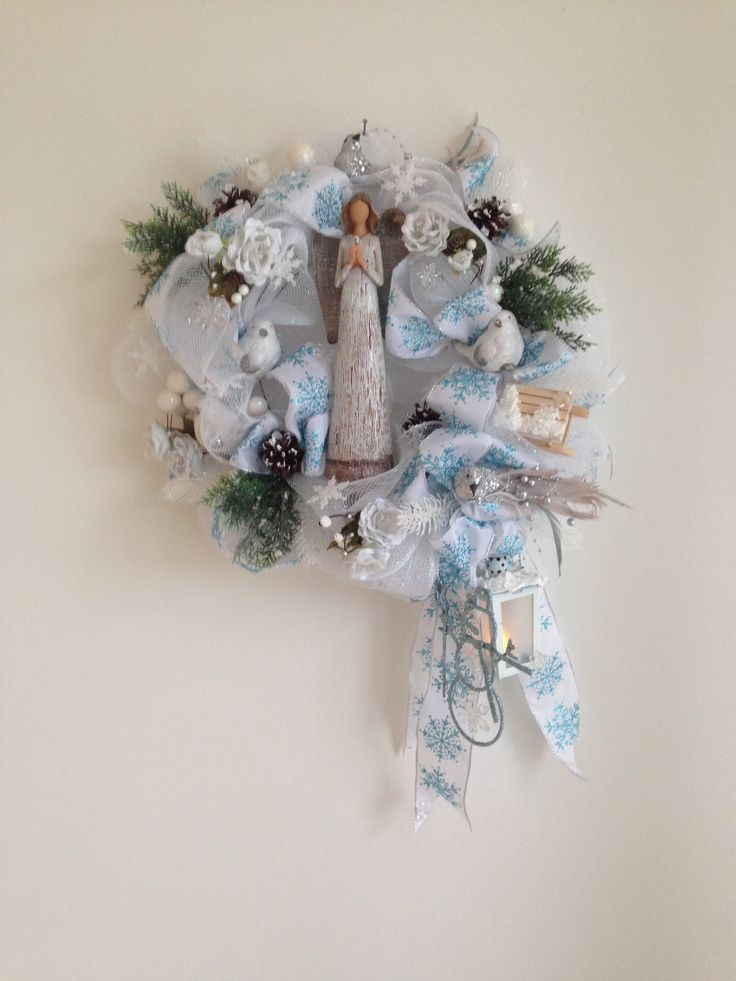 Winter wreath. Custom made. Base deco meshand snowflake bow. Added winter picks, birds, lantern, snowman, snowflakes, pinecones, decorated sledge and angel.  More at https://www.facebook.com/Moje-vence-995508700482994/