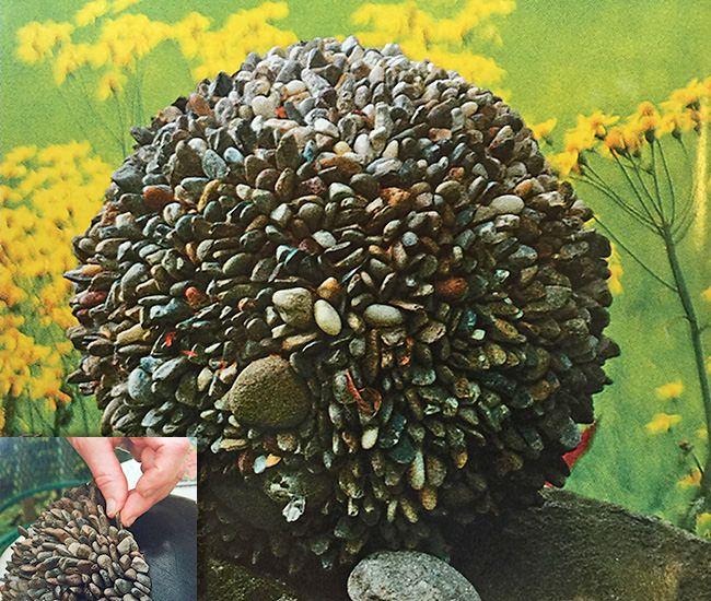 DIY garden globe pebble bowling ball. Use pebbles and E6000 to create this garden piece.