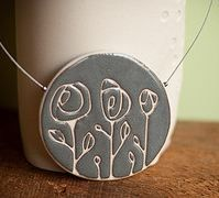 lovely pendant by Soleil Fleming (etsy artist Maboue) - porcelain jewellery