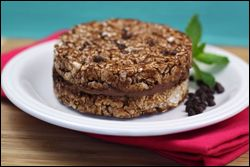 Triple Chocolate Freezy Crunchcake...a ginormous ice cream sandwich easily made with 3 ingredients...1/4 cup light chocolate ice cream, 1 tsp mini choco chips, 2 chocolate rice cakes...just 199 calories or 5 WW points+