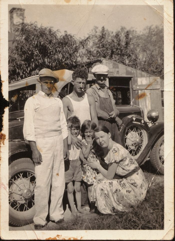 """Submitted by Robert H.: Here' one of my family in Cedarville, Cumberland County, #NewJersey (the spare tire cover is painted """"Bridgeton, N.J.""""). The men Left to right are - Elber Beal, Robert L. Howey, Jr., Robert L. Howey, Sr. and the woman kneeling is Catherine Webb Howey (wife of Robert, Jr.). Children are Robert J. Howey and Catherine E. L. Howey.  Photo taken c. 1935. Discover more history @ www.thehistorygirl.com"""