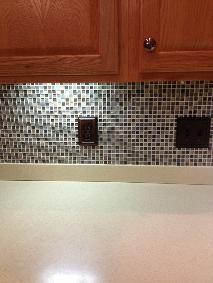 mosaic tile backsplash oak cabinets corian countertops