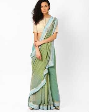 Check out Printed Saree with Contrast Border on AJIO!