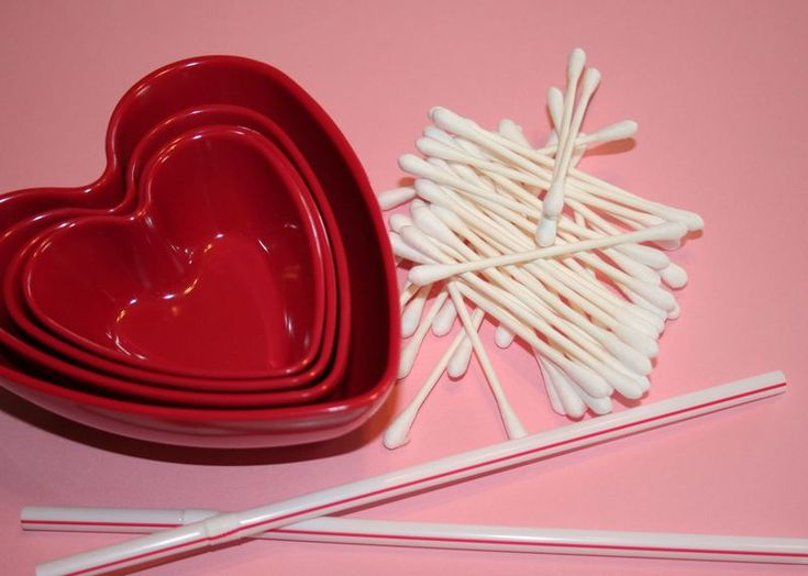 "valentine game. shoot cupid's ""arrows"" (q-tips) by blowing through straw into bowl. most in bowl, wins."