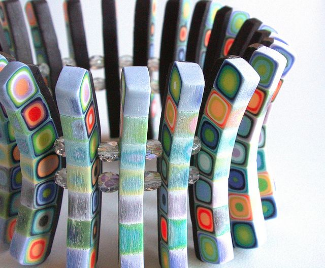 a bracelet of polymer clay by Silvia Ortiz de la Torre (note to self... check out Wanda's board for more clay ideas.