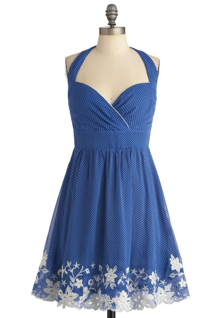 Such a cute spring dress, with the flower embroidery and tiny polka-dots…